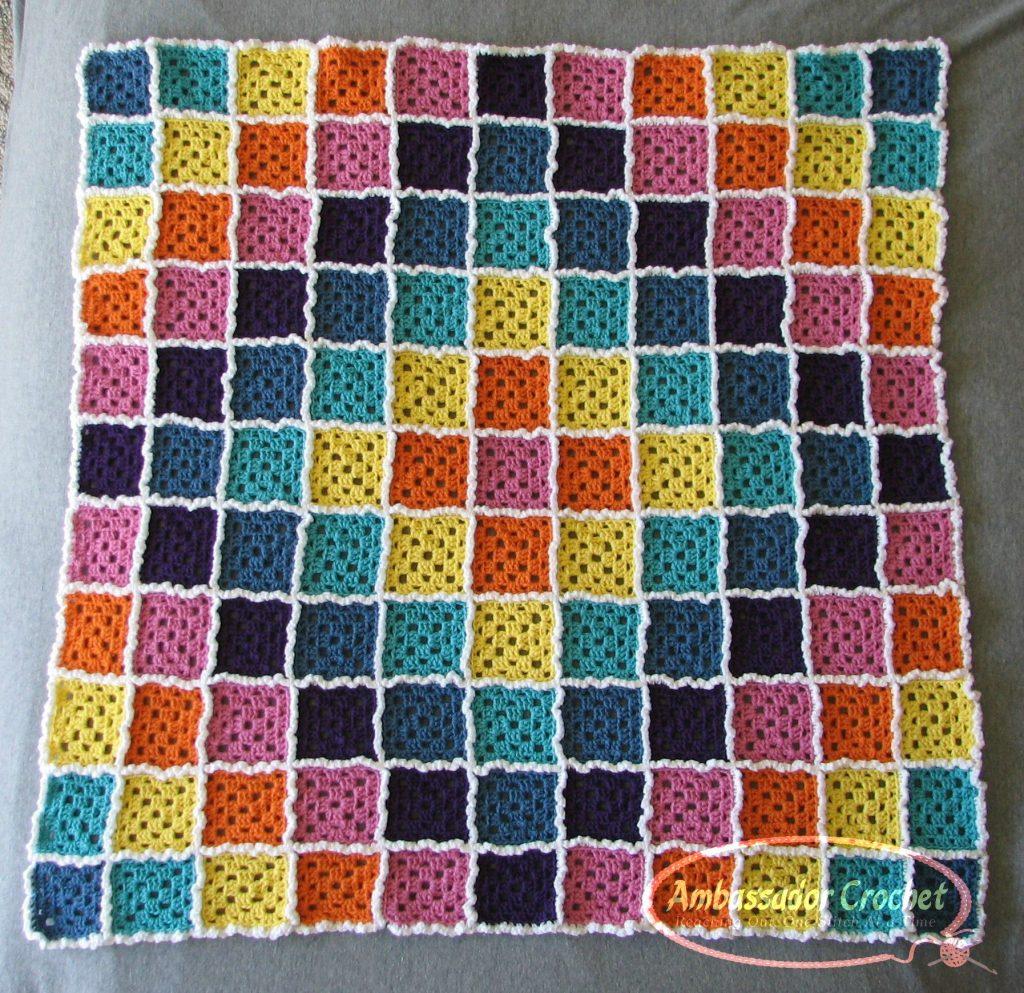 Candy Cloud Burst rainbow baby afghan by Ambassador Crochet.